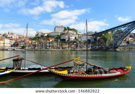 Rabelo Boat (Portuguese: Barcos Rabelo) moored at the quarry at Porto Old City, Portugal. Rabelo Boats are traditional vessels transport wine from Douro Valley to the city of Porto.  - stock photo