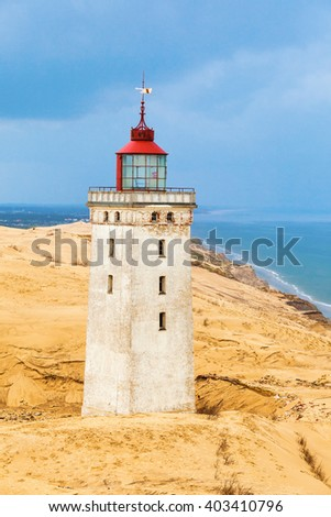 Rabjerg mile a lighthouse on the Danish coast in a sand dune - stock photo