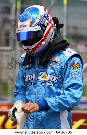 Race car driver suiting up. - stock photo