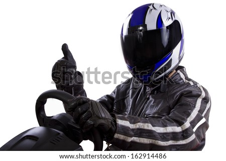 race car driver wearing protective leather and helmet - stock photo