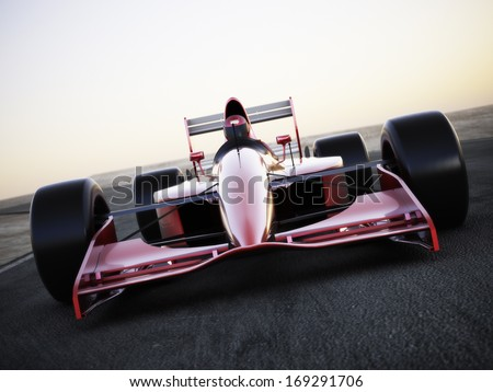 race car racing on a track front view with motion blur