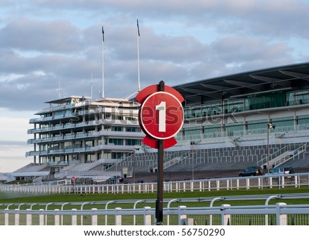 Racecourse and grandstand in early morning - stock photo