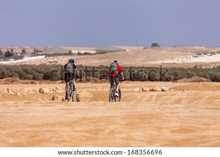 racers bike desert area summer day - stock photo