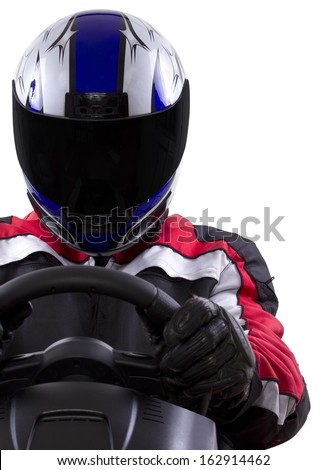 racerwearing red racing suit and blue helmet on a steering wheel - stock photo