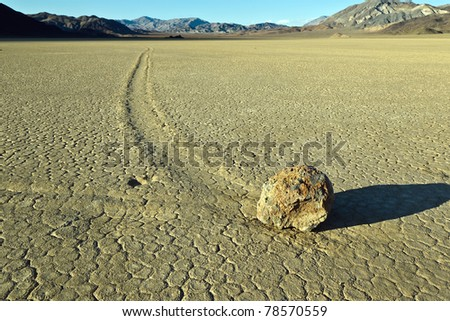"Racetrack Playa, Death Valley National Park, California. The Racetrack Playa, or The Racetrack, is a scenic dry lake feature with ""sailing stones"" that leave linear ""racetrack"" imprints. - stock photo"