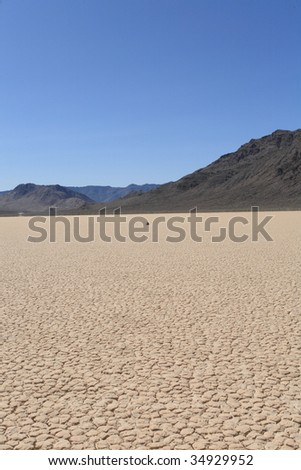 Racetrack playa in death valley-12 - stock photo
