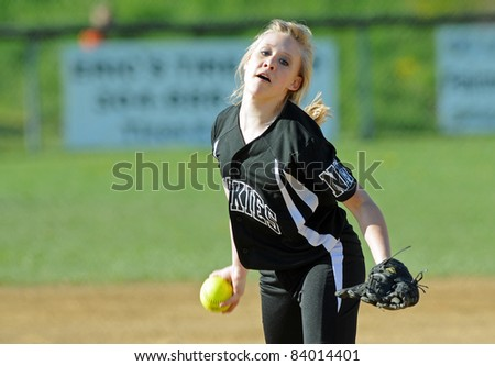 RACHEL, WV - APRIL 21: North Marion HS (WV) softball pitcher Chelsi Latocha delivers a pitch in a game against Cameron April 21, 2011 in Rachel, WV. - stock photo
