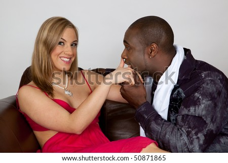Racially mixed couple, he kissing her hand