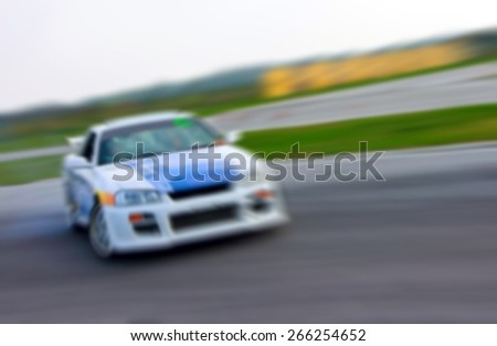 racing car drifting on the track, blurred for presentation, abstract background - stock photo