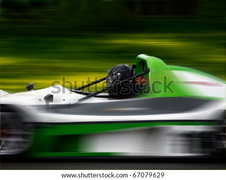 Racing car moving fast - stock photo