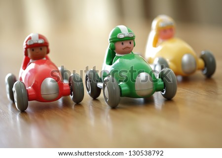 Racing cars on a table top racetrack concept for competition or childhood - stock photo