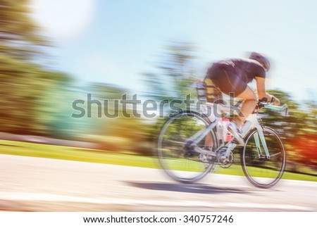 Racing Cyclist, motion blurred image - stock photo