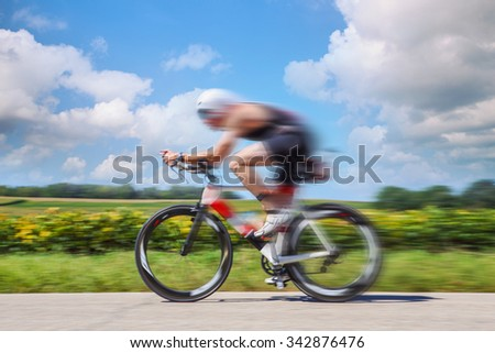 Racing Cyclist. Motion blurred image