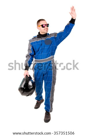 Racing driver greeting the crowd with helmet and sunglasses isolated in white