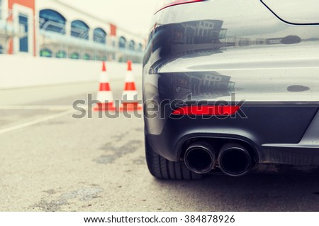racing, motosports, extreme and motoring concept - close up of sports car back on speedway of stadium - stock photo
