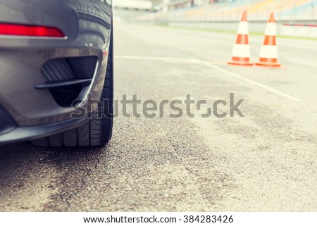 racing, motosports, extreme and motoring concept - close up of sports car front on speedway of stadium - stock photo