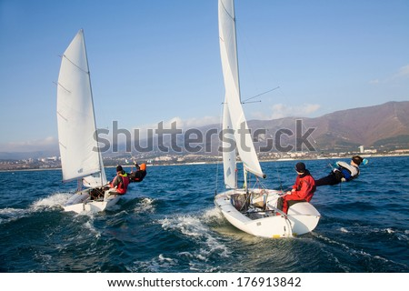 Racing Sailboat in the sea on a sunny day - stock photo