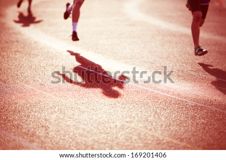 Racing shadows - stock photo