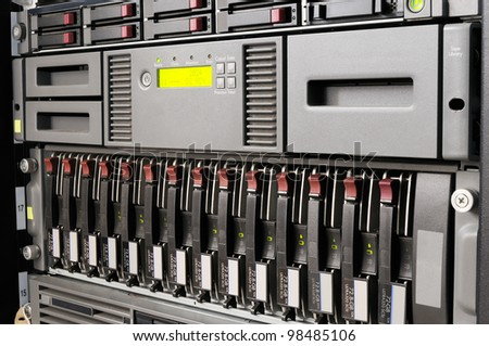Rack mounted blade servers, system storage and tape library - stock photo