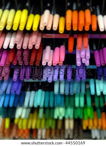 rack of brightly-colored pens; differential focus - stock photo