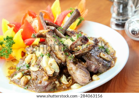 Rack of lamb grilled with aromatic olive oil, herbs and spices - stock photo