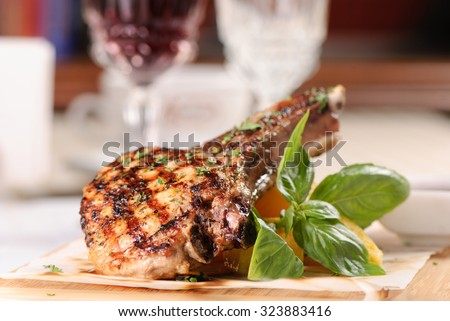 Rack of pork grilled with garnish - stock photo
