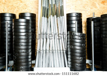 rack of weights and chromed dumbbells - stock photo