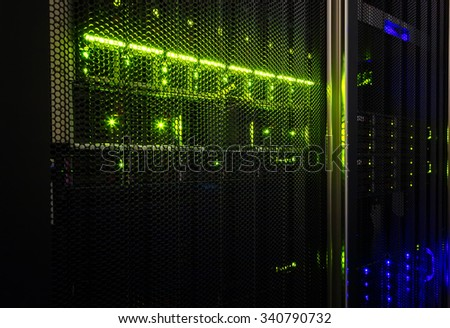 rack with blade behind bars mainframe in the data center - stock photo