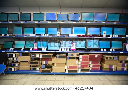 Rack with liquid crystal displays and monitors in electronics shop - stock photo
