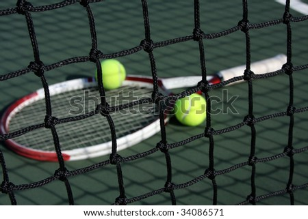 Racket and tennis balls through the net