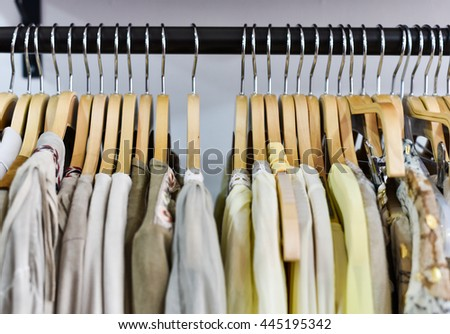 Racks of clothes in a store - stock photo
