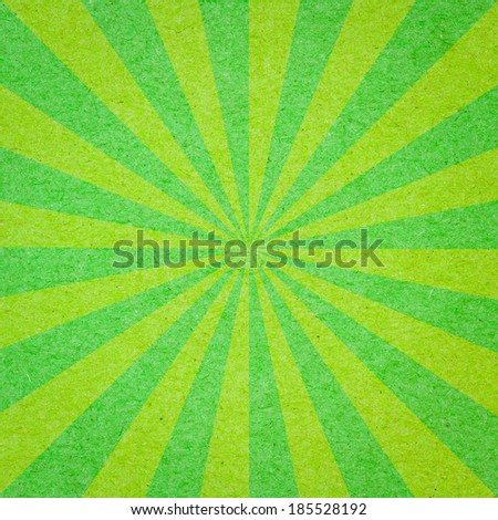 Radial background made of green recycled paper - stock photo