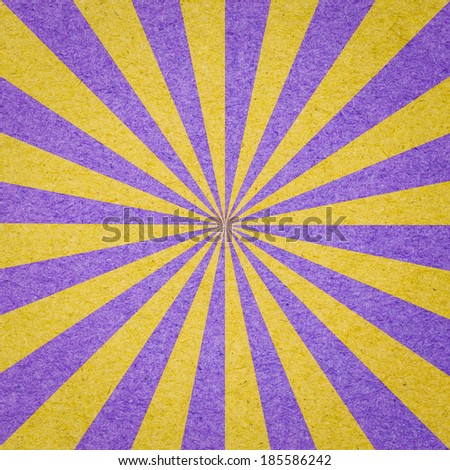 Radial background made of purple and yellow recycled paper - stock photo