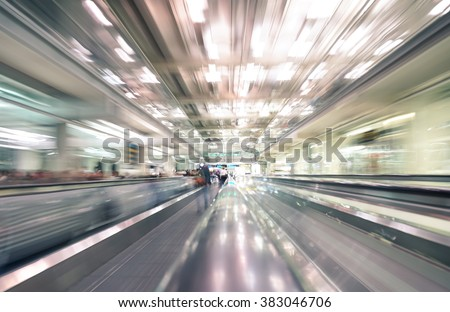 Radial zoom defocused treadmills with motion blur -  Modern international airport - Concept of travel around the world and wanderlust feelings - stock photo