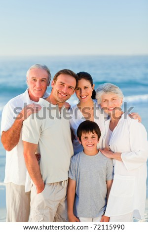 Radiant family at the beach - stock photo