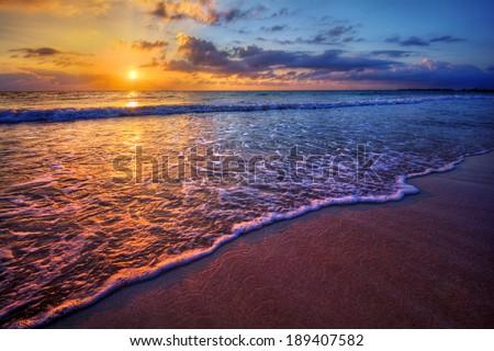 Radiant sea beach sunset - stock photo