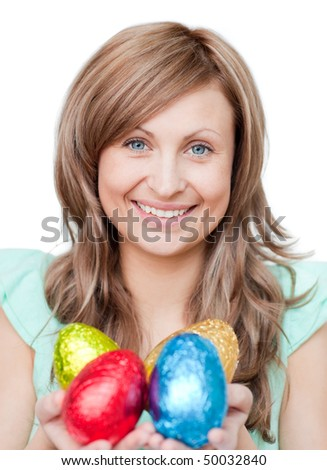 Radiant woman showing colorful Easter eggs - stock photo