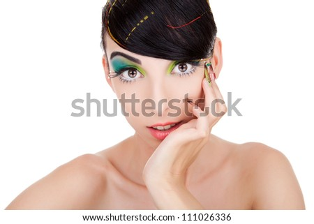 Radiant young woman looking surprised at the camera and holding her hand on her face - stock photo