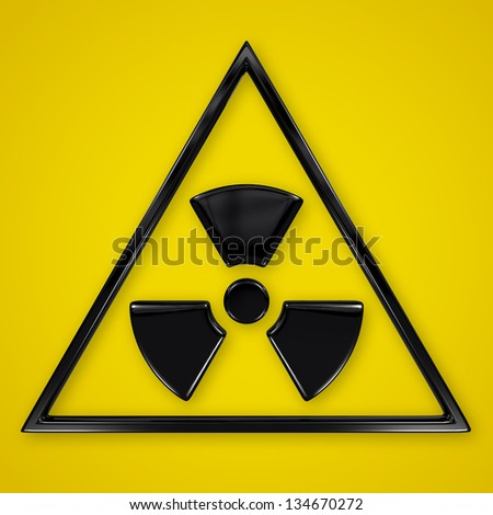 Radiation symbol in triangle on yellow - stock photo