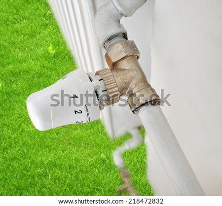 Radiator heating saving energy, conceptual - stock photo