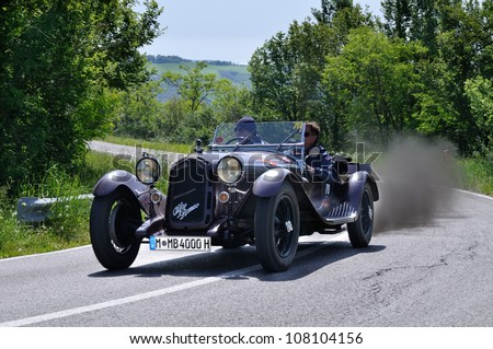 RADICOFANI (SI) ITALY - MAY 19: Brown Alfa Romeo 6c 1750 GS built in 1930, driven by Hanno Mayr takes part to the 1000 Miglia 2012, on May 19, 2012 in Radicofani (SI)