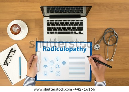 Radiculopathy Doctor writing medical records on a clipboard, medical equipment and desktop on background, top view, coffee - stock photo