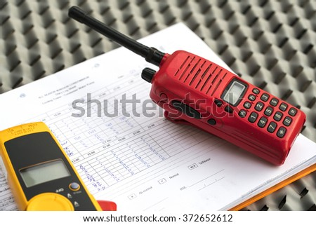 Radio communications on paper, check the lights on the buildings. - stock photo