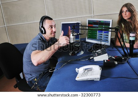 radio dj man indoor at radio studio - stock photo