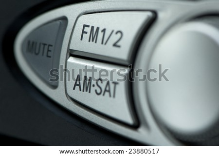 Radio knobs on a car stereo - stock photo