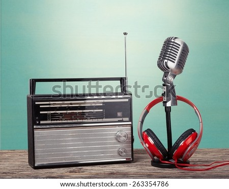 Radio. Retro radio, red microphone, headphones on table old style photo - stock photo