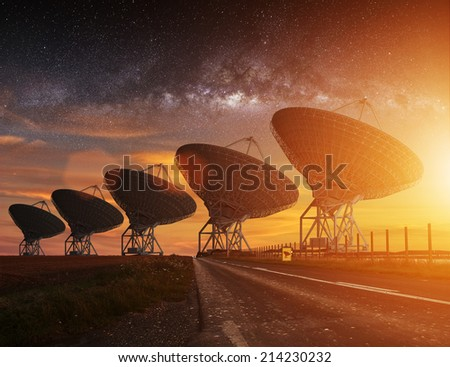 Radio Telescope view at night with milky way in the sky - stock photo