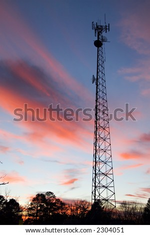 Radio Tower with colorful evening sky - stock photo