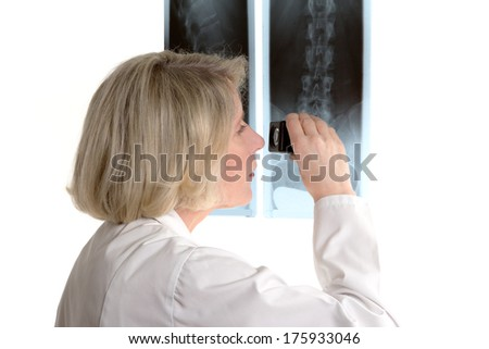 Radiologist examining a radiograph with a magnifying glass, isolated on white, copy space