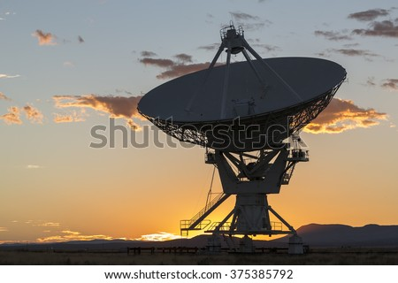 Radiotelescopes at the Very Large Array, the National Radio Observatory in New Mexico at sunset - stock photo
